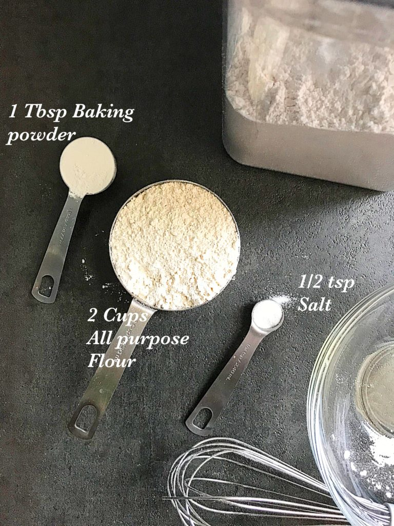 a Tbsp of baking powder, a 2 cup flour, a 1/2 tsp salt and a canister filled with homemade self rising flour
