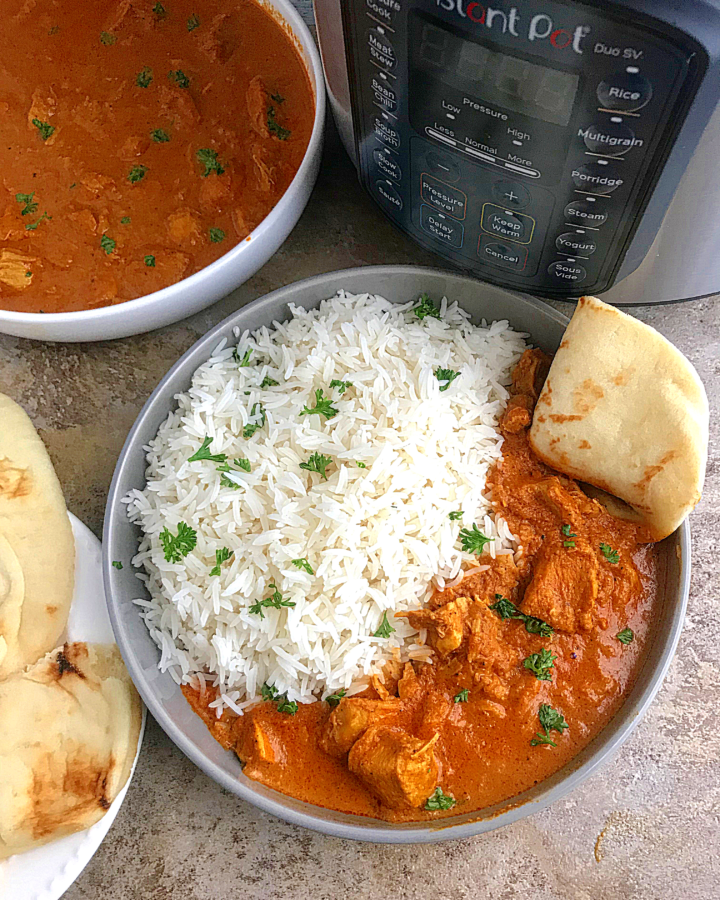 white rice served with Indian tikka masala and some naan bread