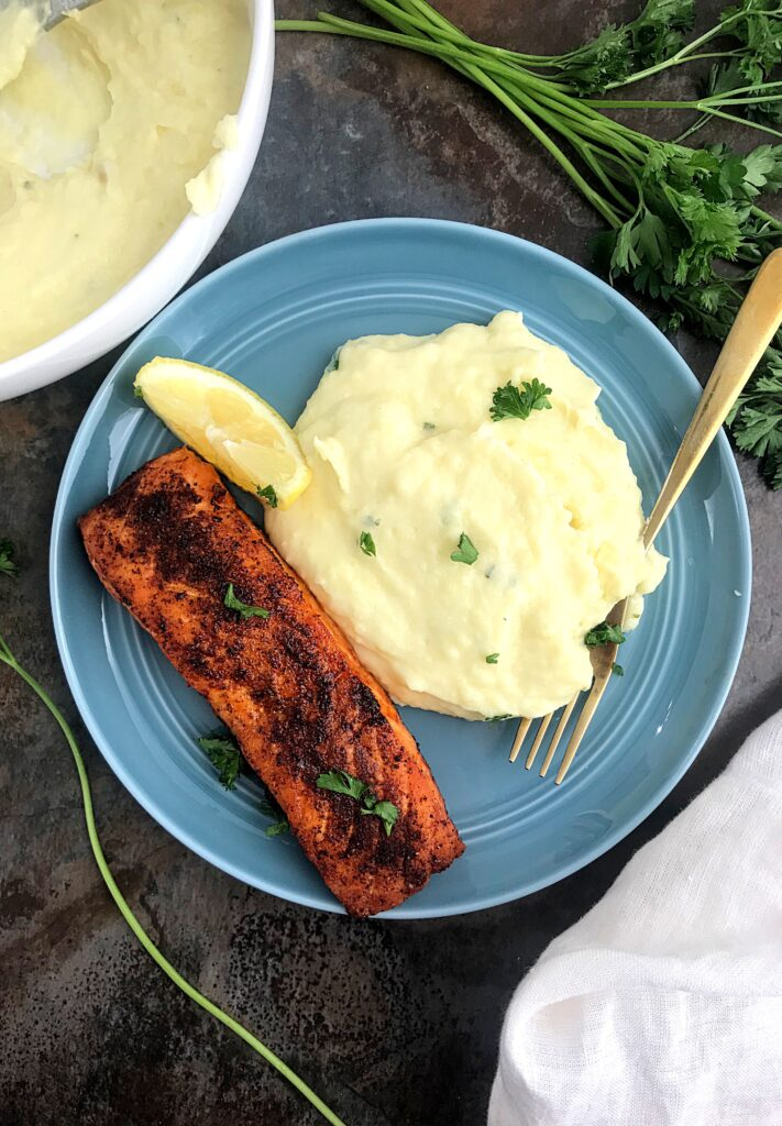 Mashed Potatoes and baked salmon served in a blue plateServed