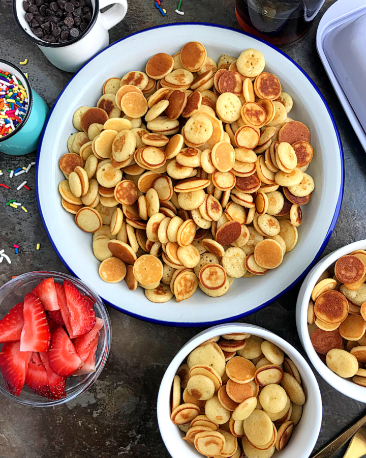 Trending mini pancakes served in different bowls with different pancake toppings like sprinkles and chocolate chips