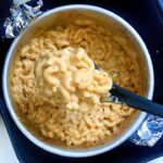 A close shot of air fryer Mac and cheese in a black spoon