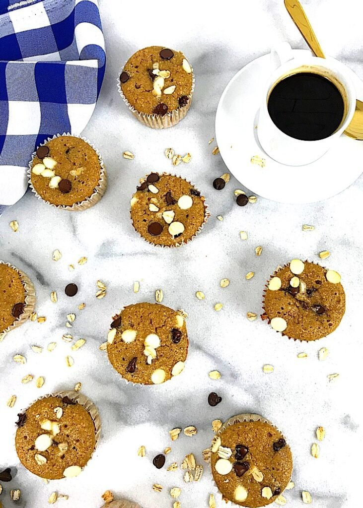 top view of oatneal muffins with a cup of coffee and a blue gingham napkin