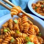 rotini pasta in between chopsticks