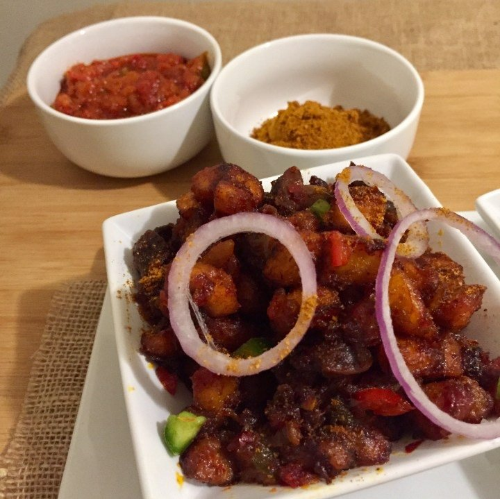 gizzard and fried plantains served with soya spice and onions